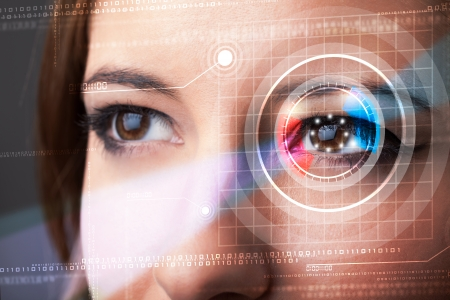 eye closeup: Modern cyber woman with technolgy eye looking Stock Photo