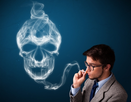 Handsome young man smoking dangerous cigarette with toxic skull smoke Stock Photo - 23783023