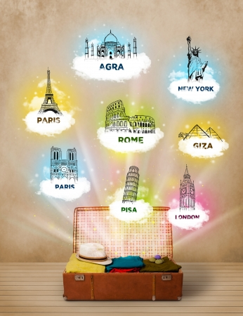 Tourist suitcase with famous landmarks around the world on grungy background photo