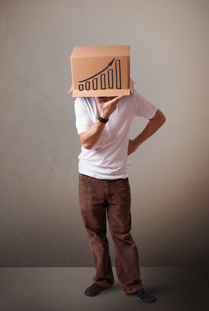 masquerader: Young man standing and gesturing with a cardboard box on his head with diagram