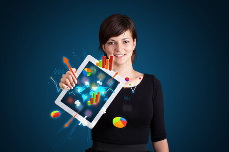 beutiful woman holding modern tablet with colorful diagrams and graphs photo