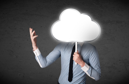 obscurity: Businessman standing and hiding his head behind an empty cloud