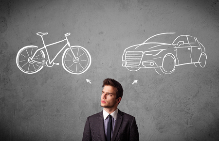 good looking: Young businessman taking a decision between bicycle and car