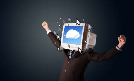 database icon: Business man with a monitor on his head, cloud system and pointers on the screen on a dark background Stock Photo