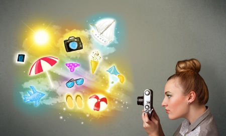 Beautiful teenage photographer making photos of holiday painted icons Stock Photo - 24118594