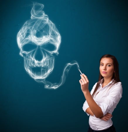 Pretty young woman smoking dangerous cigarette with toxic skull smoke Stock Photo - 24174036