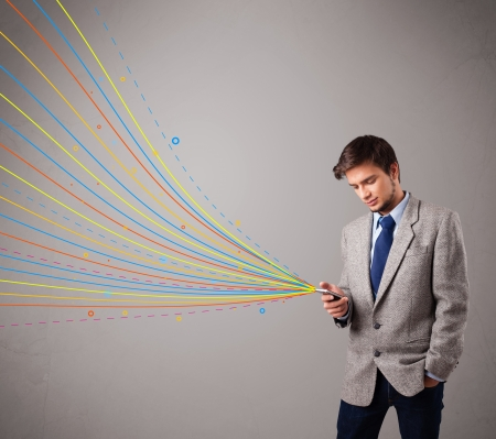 handsome young man holding a phone with colorful abstract lines photo