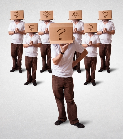 Group of handsome people gesturing with sketched question marks on box photo