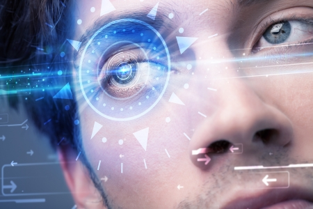 futuristic eye: Modern cyber man with technolgy eye looking into blue iris