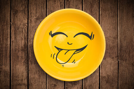 natural face: Happy smiley cartoon face on colorful dish plate and grungy background