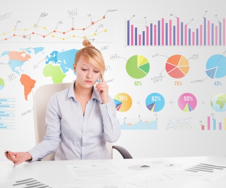 Business woman with colorful charts graphs photo