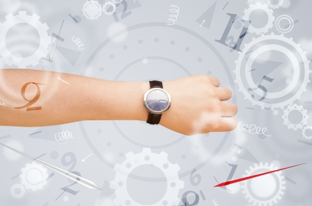 Hand with watch and numbers comming out on the side Stock Photo - 24252687