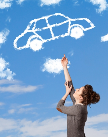car concept: Casual young girl looking at car cloud on a blue sky