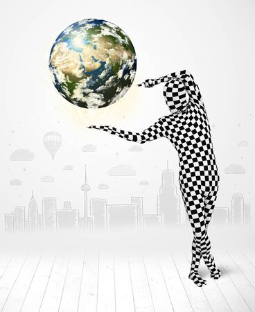Funny man in full body suit holding planet earth photo