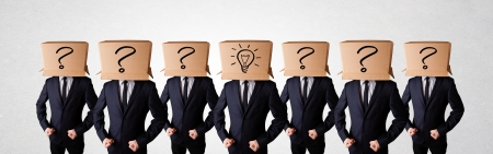 Group of handsome people gesturing with sketched lighbulbs and question mark on box photo