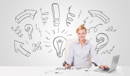 Attractive young businesswoman brainstorming with drawn arrows and symbols photo