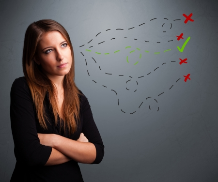theorize: Beautiful young woman choosing between right and wrong signs Stock Photo