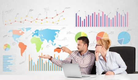 Business man and woman with colorful charts graphs photo