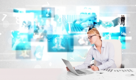 Business person at desk with modern blue tech images  photo