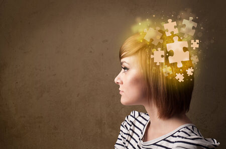 Young person thinking with glowing puzzle mind photo