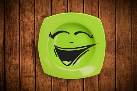 Happy smiley cartoon face on colorful dish plate photo