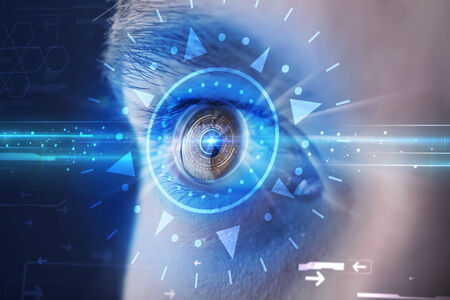 Modern cyber man with technolgy eye looking into blue iris photo
