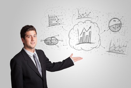 Business man presenting hand drawn sketch graphs and charts concept photo