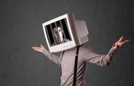 Business man with monitor screen on his head traped into a digital system concept Stock Photo - 24563893