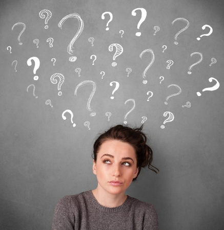 Pretty young woman thinking with sketched question marks all over her head Stock Photo - 24592223