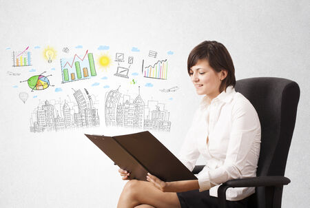 Cute woman sketching city and graph icons and symbols photo