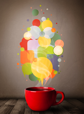 steamy: Tea cup with colorful speech bubbles, close up Stock Photo