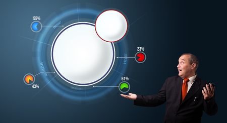 crazy businessman in suit holding a phone and presenting abstract modern pie chart with copy space photo