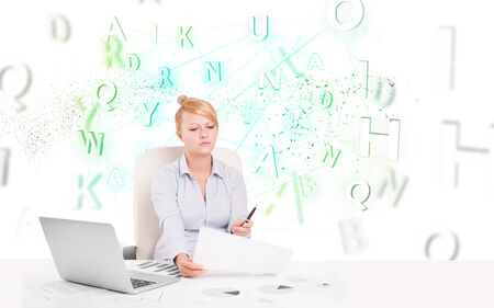 Business woman at white desk with green word cloud photo