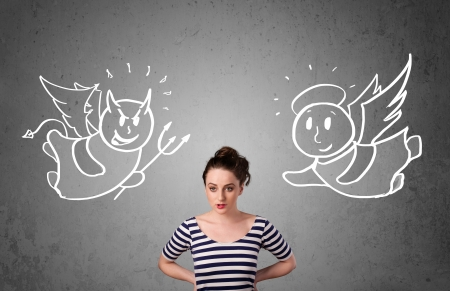 Young woman standing between the angel and the devil drawings Stock Photo - 25015319