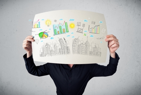 Businessman holding a paper in front of his head with charts and cityscape drawing photo