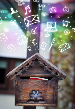 Colorful modern icons and symbols bursting out of a mailbox photo