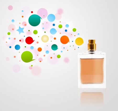 Perfume bottle spraying colorful bubbles photo