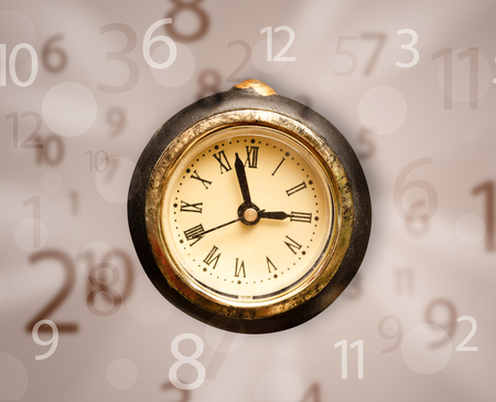 Vintage clock with numbers comming out on the side photo