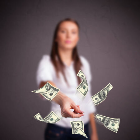 Beautiful young girl throwing money Stock Photo - 25017040