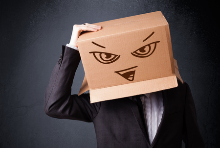 masquerader: Businessman standing and gesturing with a cardboard box on his head with evil face