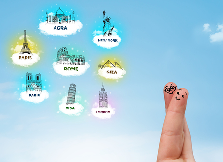 Cheerful happy smiling fingers with sightseeing landmarks icons photo