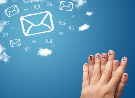 Happy cheerful smiley fingers looking at mail icons made out of clouds photo