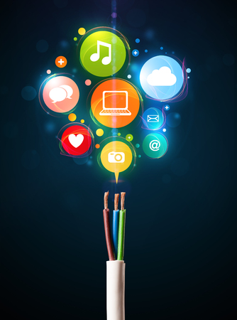 Glowing social media icons coming out of electric cable Stock Photo
