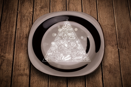 Hand drawn food pyramid on colorful dish plate and grungy background photo