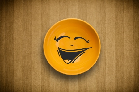 cartoon face: Happy smiley cartoon face on colorful dish plate and grungy background