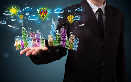 Young business man in suit presenting colorful hand drawn metropolitan city photo