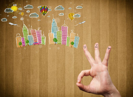 Happy cheerful smiley fingers looking at colorful handrawn cityscape photo