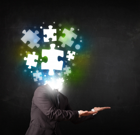 is troubled: Character in suit with glowing puzzle head concept