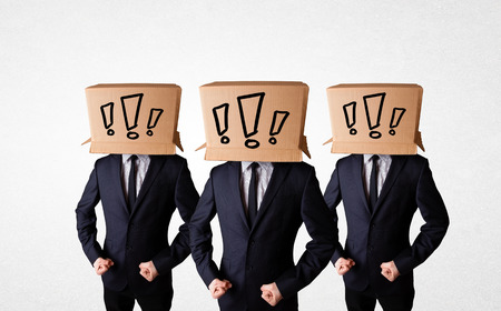 Group of men gesturing with exclamation marks drawn on box on their head photo