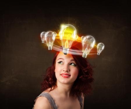 preety: Preety woman with light bulbs circleing around her head  Stock Photo